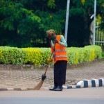 1432590044A-worker-cleans-up-a-road